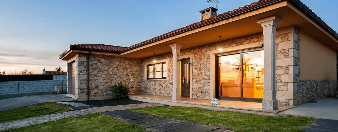 Casas de estilo rústico de MORANDO INMOBILIARIA Rústico