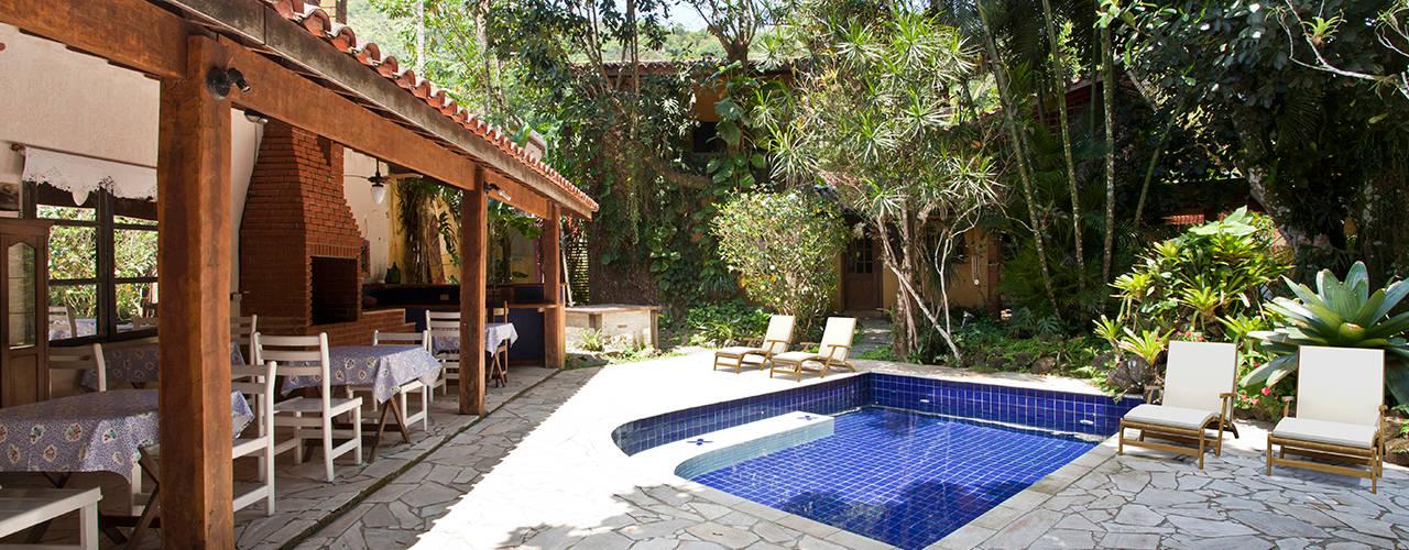 Casa Camburi Piscinas tropicais por SET Arquitetura e Construções Tropical
