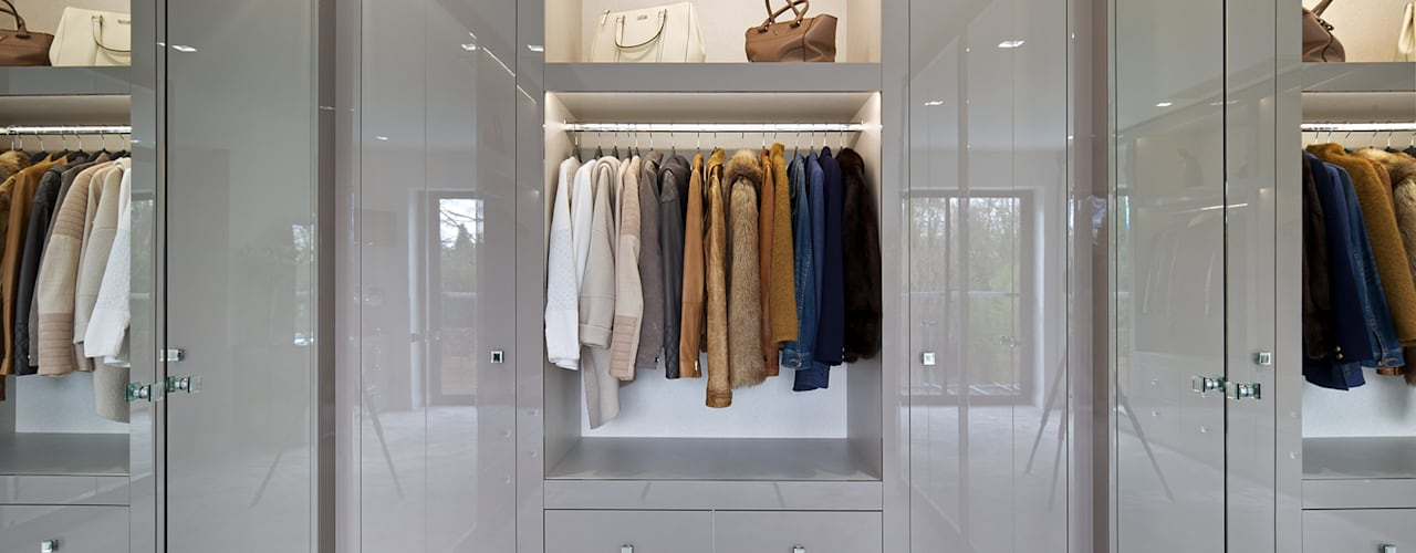Closets de estilo  por The Wood Works,