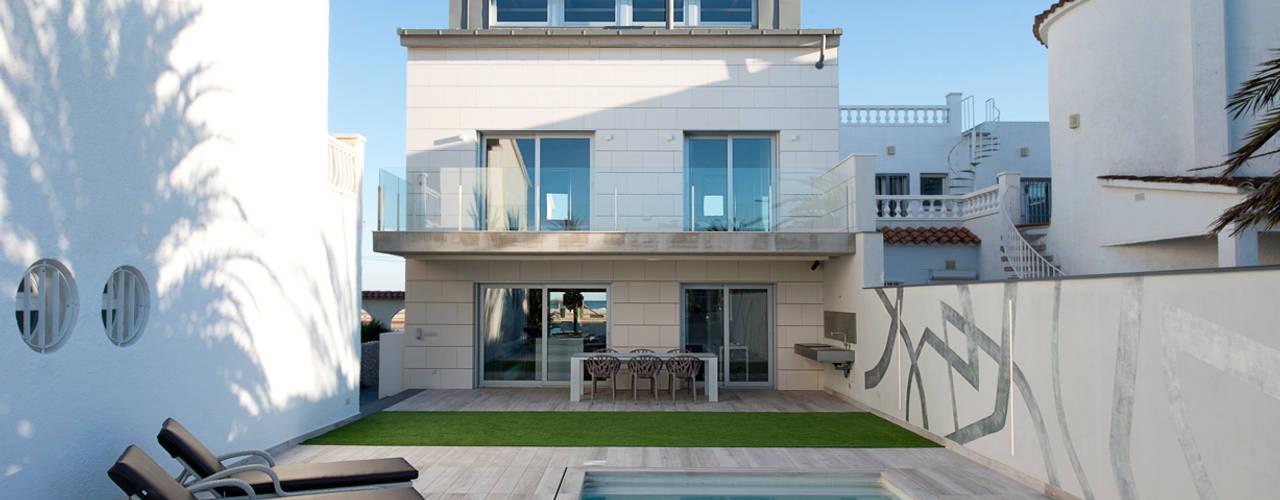 Casas minimalistas por HD Arquitectura d'interiors Minimalista