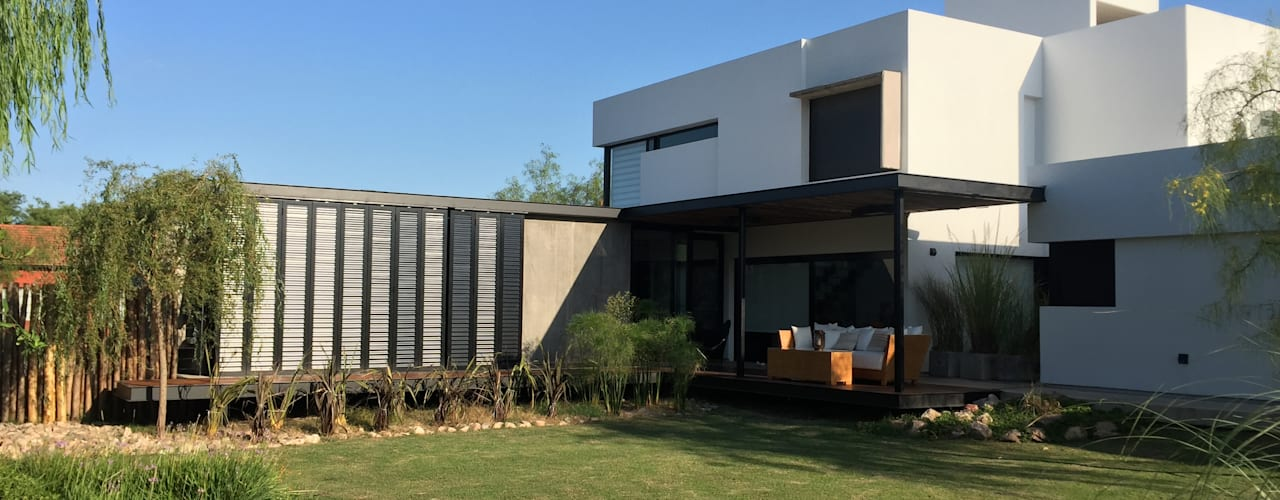 Casas de estilo  por Development Architectural group