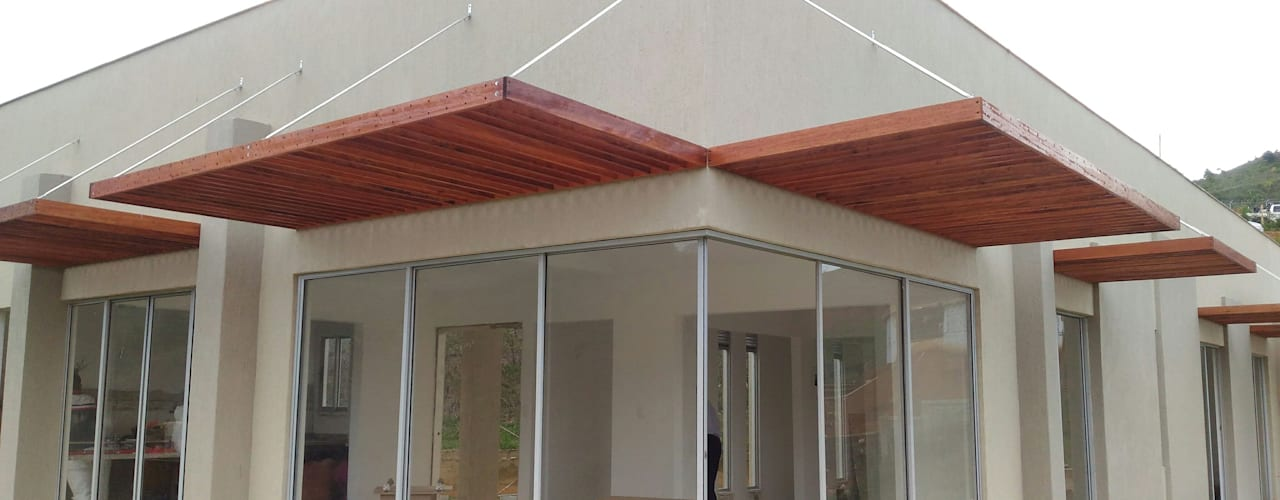 Una Casa de descanso Casas modernas de Muros y Casas S.A.S Moderno