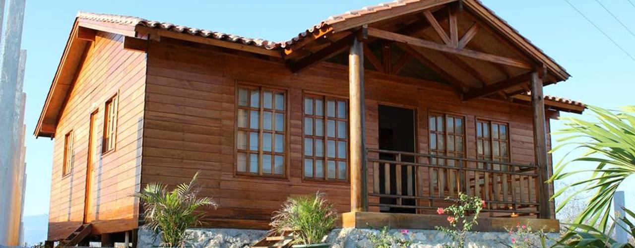 クラシカルな 家 の Casas y cabañas de Madera -GRUPO CONSTRUCTOR RIO DORADO (MRD-TADPYC) クラシック