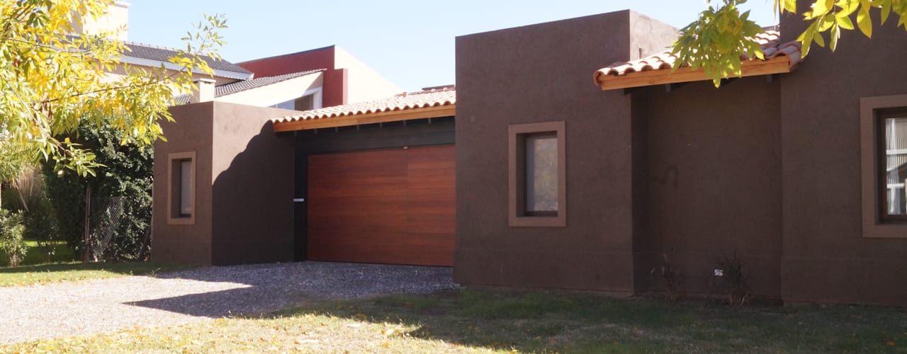 Houses by Abitar arquitectura, Rustic