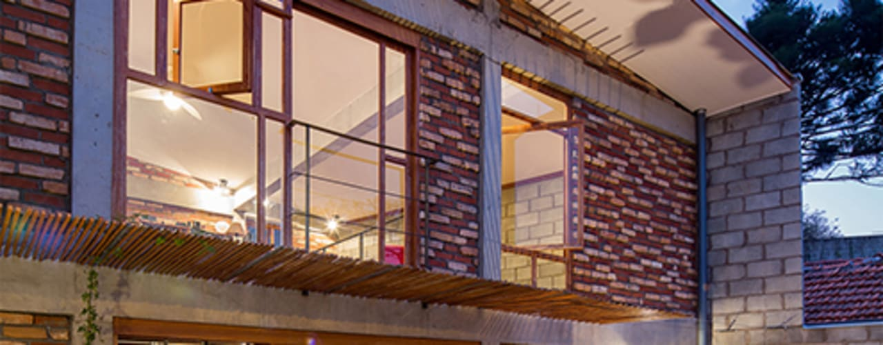 Casas de estilo moderno por Grupo Garoa Arquitetos associados