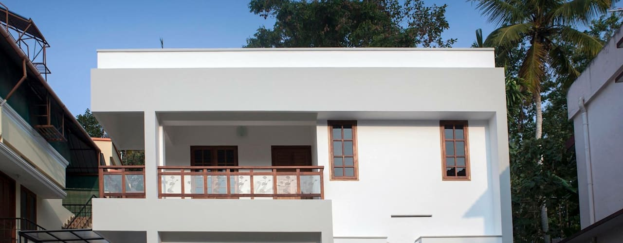 1400sqft House in Trivandrum:  Houses by Wohnhaus Developers