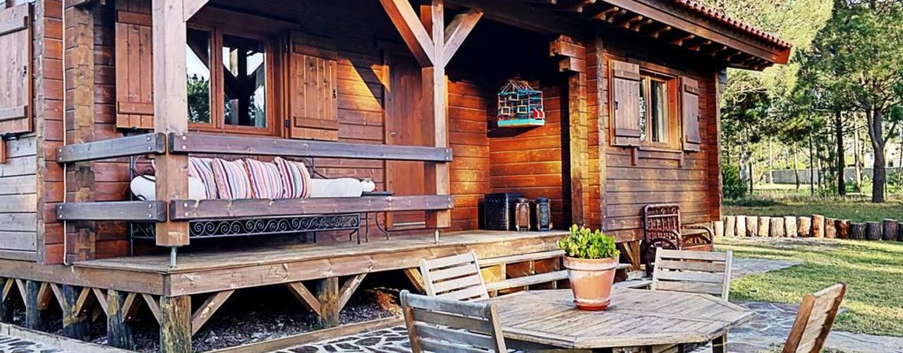 Casas de madera de estilo  por Rusticasa, Rural