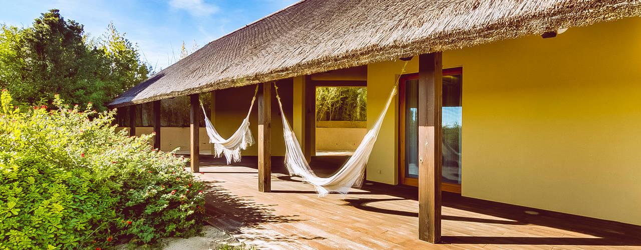 Projekty, rustykalne Domy zaprojektowane przez Ivo Santos Multimédia