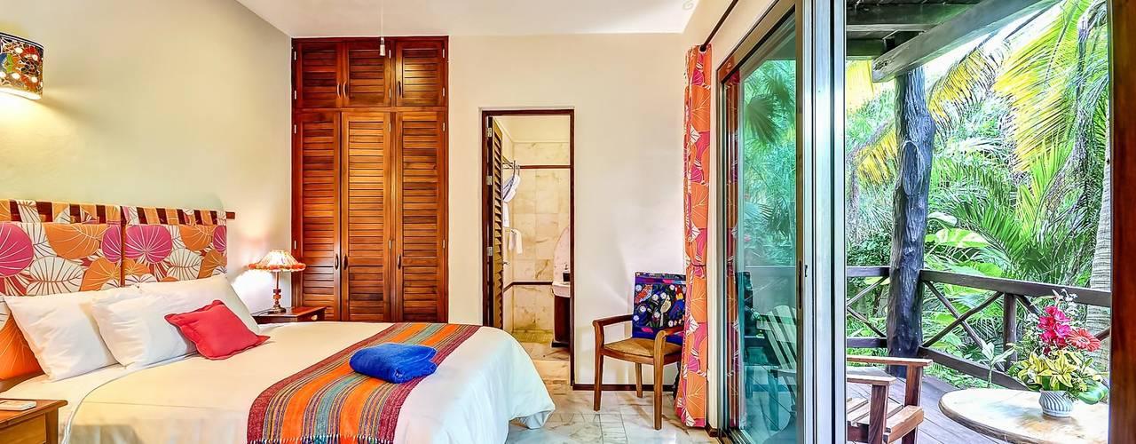 Sombras del viento: Recámaras de estilo topical por DHI Riviera Maya Architects & Contractors