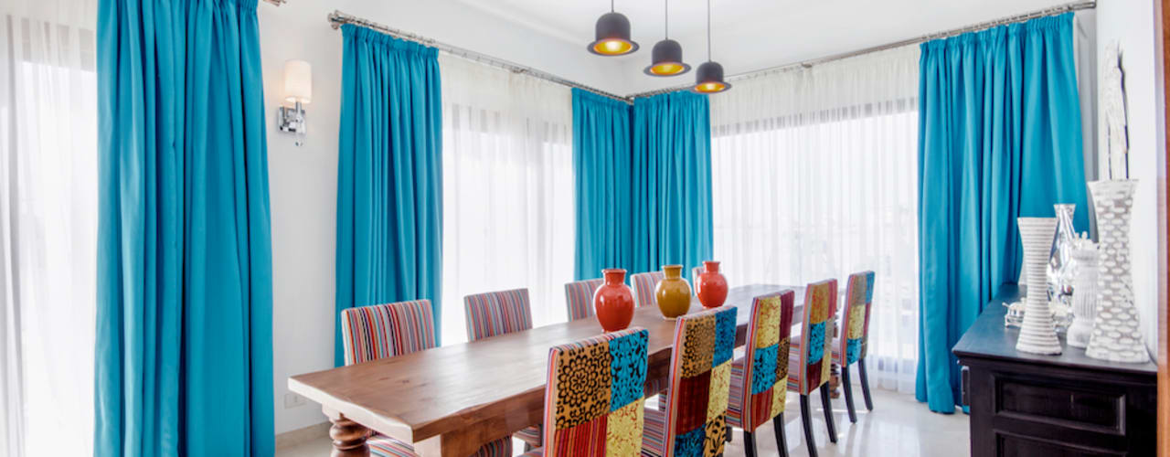 Dining room by COCA INTERIORS