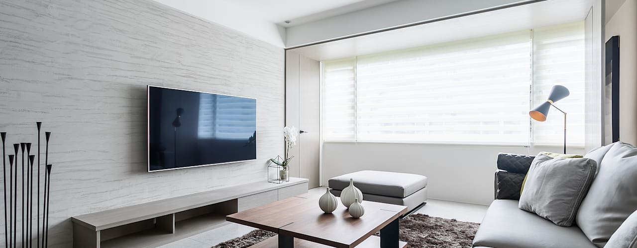 Living room by E&C創意設計有限公司