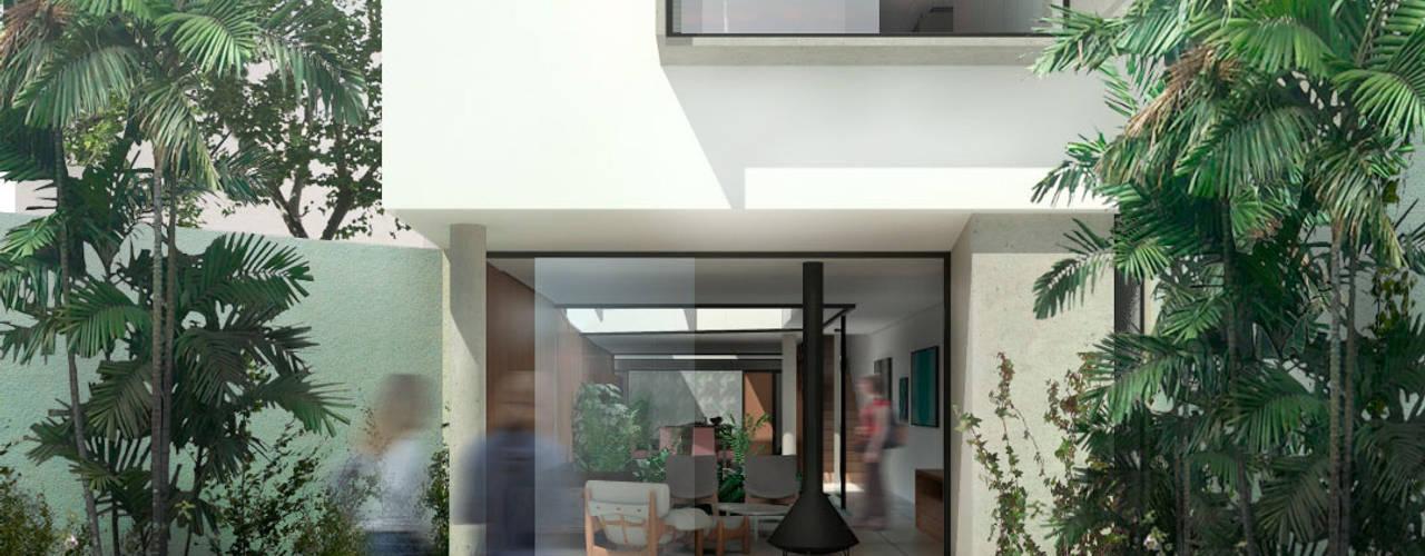 Front yard by ODVO Arquitetura e Urbanismo