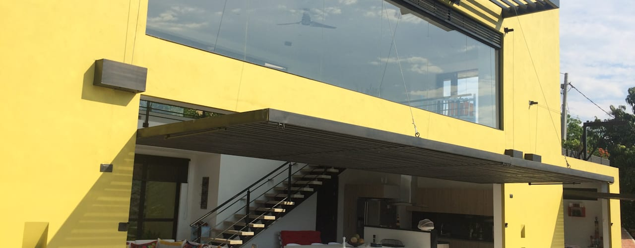 : Casas de estilo  por Arquitectos y Entorno S.A.S,