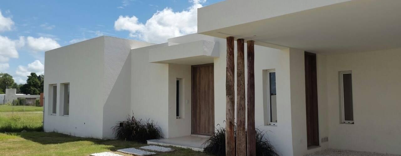Casas de estilo  por Estudio Victoria Suriguez