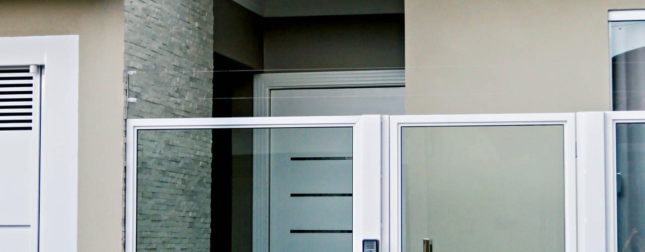 Carla Monteiro Arquitetura e Interiores Modern houses