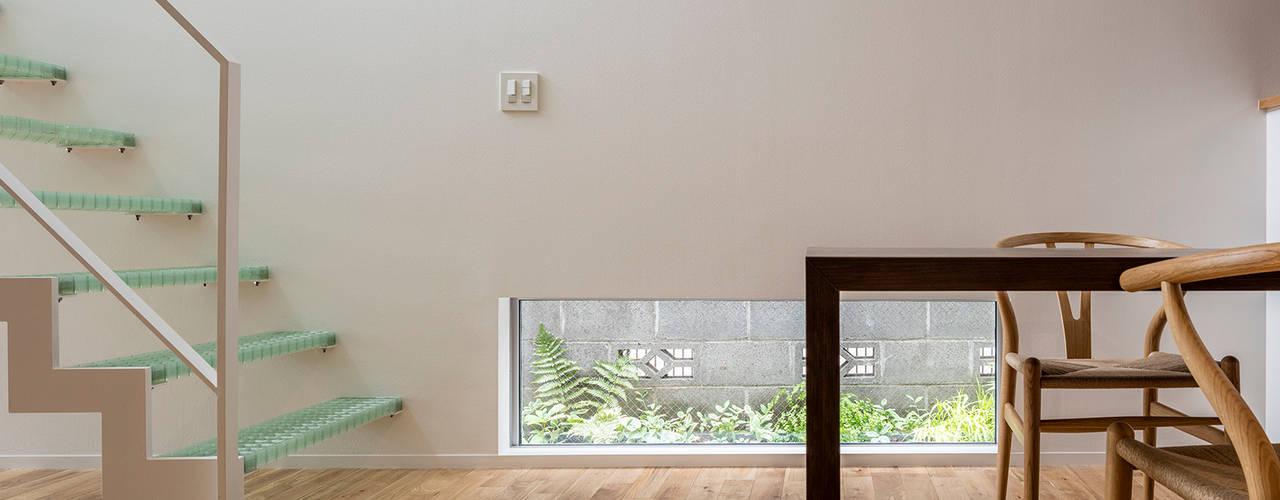 府中の家: 前田篤伸建築都市設計事務所が手掛けたダイニングです。