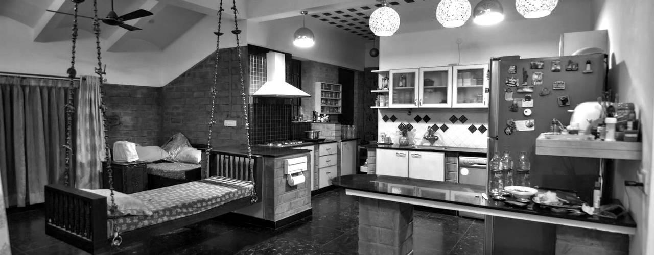 Kitchen cum family: modern Kitchen by Myriadhues