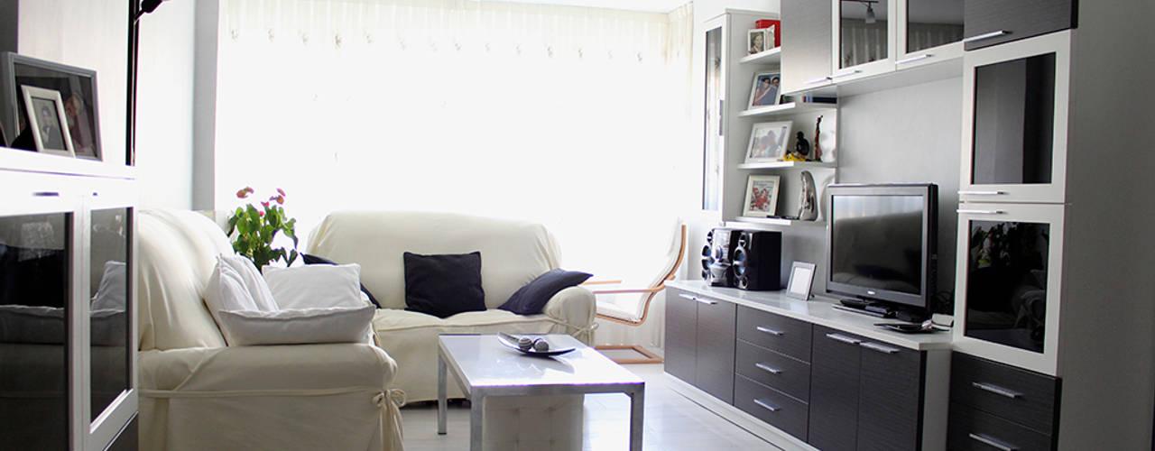 Reforma integral en Madrid de piso de 80m2: Salones de estilo  de GRUPO STYLO REFORMAS Y DECORACIÓN S.L.