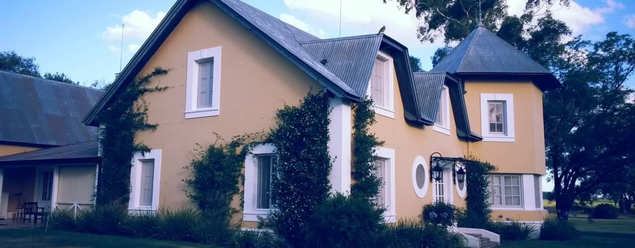Casas de campo de estilo  por Estudio Dillon Terzaghi Arquitectura - Pilar