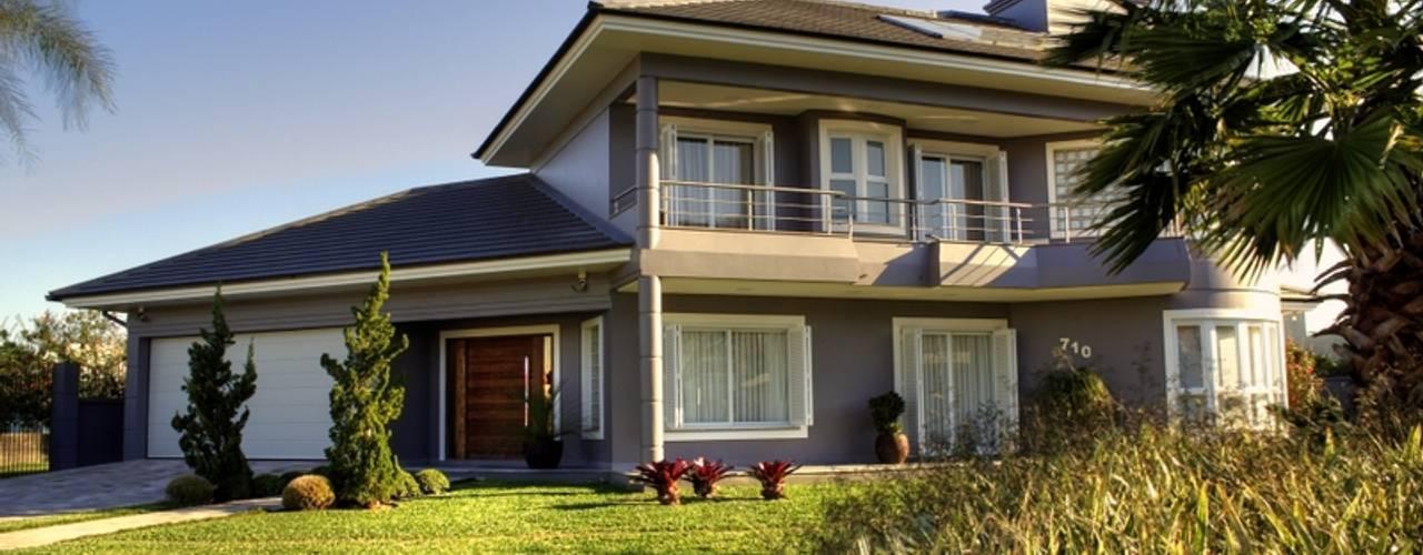 REFORMA RADICAL: Casas familiares  por Maciel e Maira Arquitetos