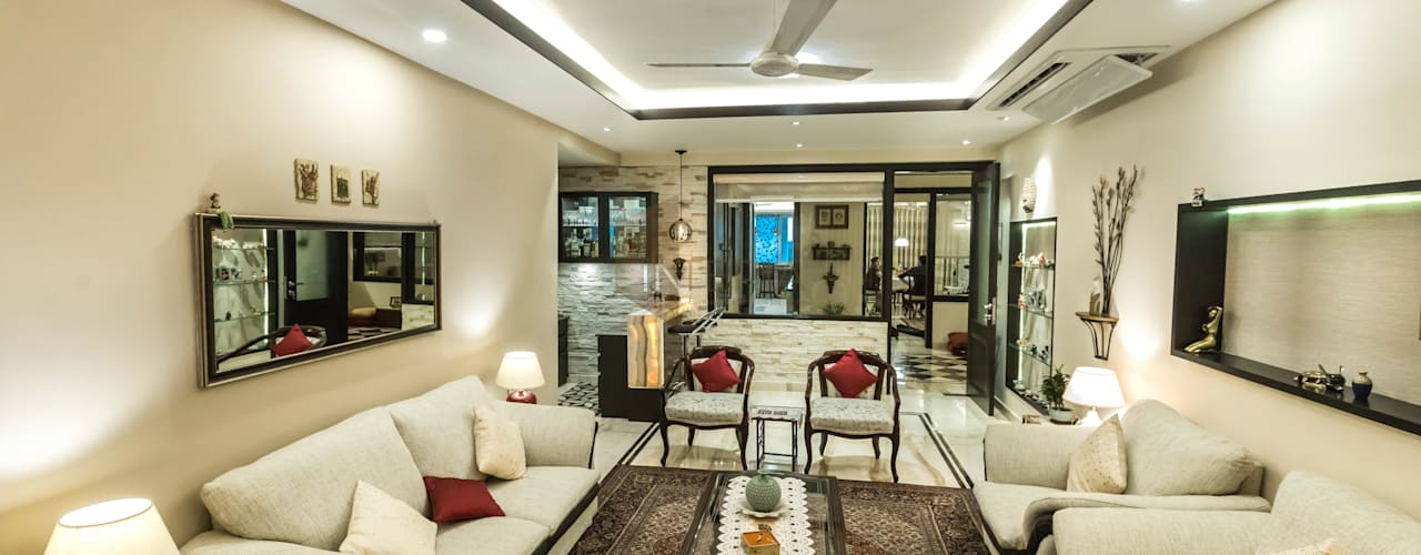 Ambience Lagoon: eclectic Living room by UK Interia Pvt Ltd