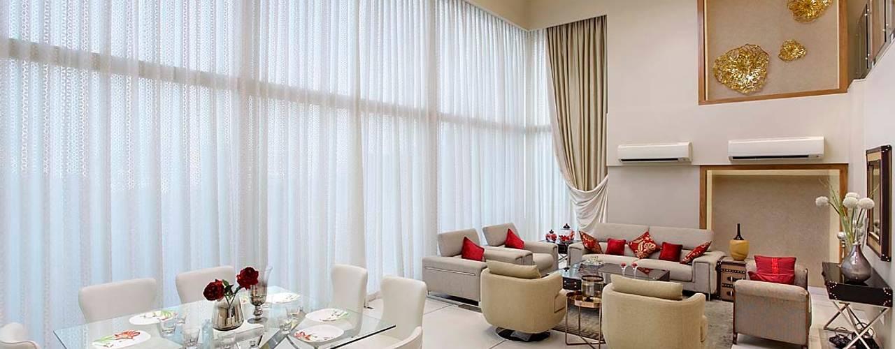 Sand Dunes Pent House :  Living room by Mahesh Punjabi Associates