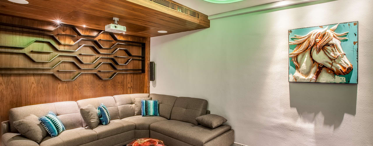 The mural apartment:  Media room by S Squared Architects Pvt Ltd.