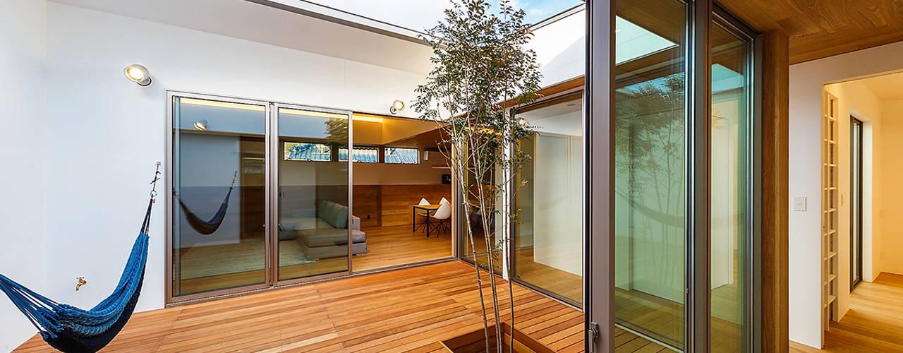 haus-flow 一級建築士事務所haus 北欧風 庭 木 ブラウン