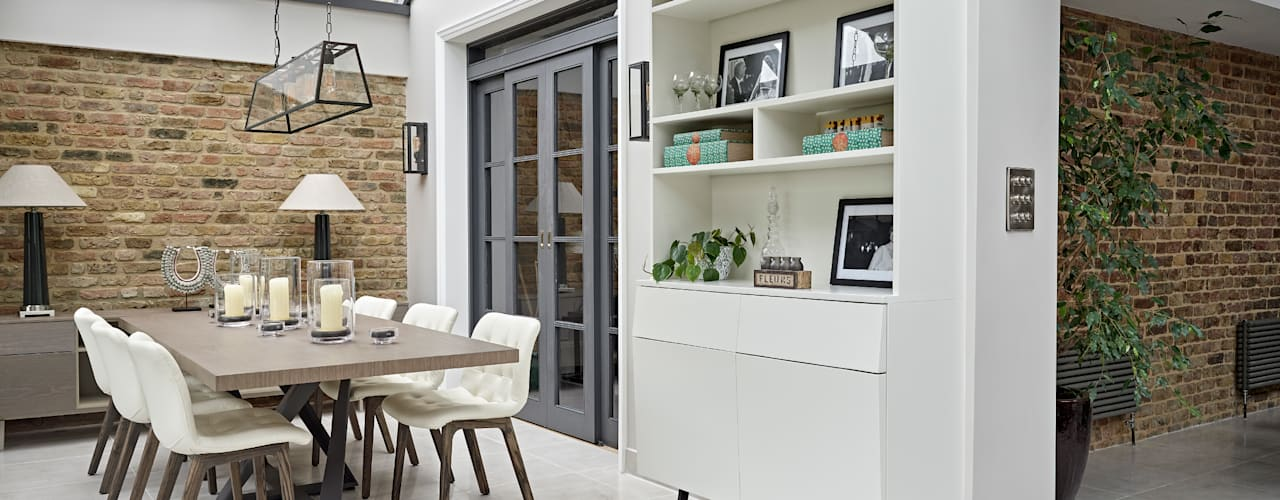 Salle à manger de style  par Tailored Living Interiors