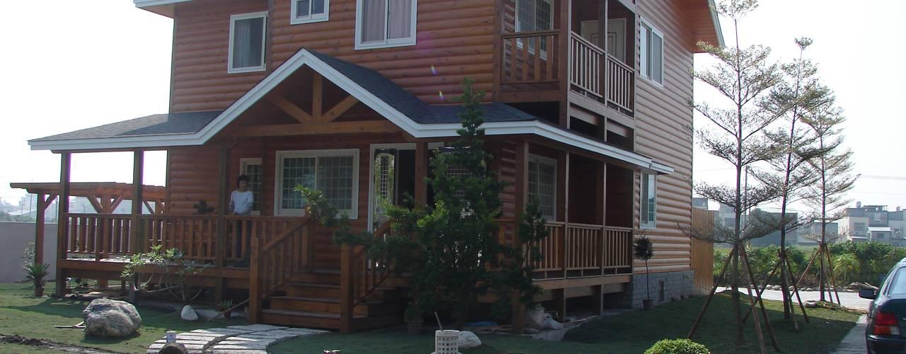 Rustic style house by 安居屋有限公司 Rustic