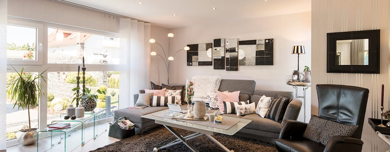 Salas / recibidores de estilo  por FingerHaus GmbH - Bauunternehmen in Frankenberg (Eder)