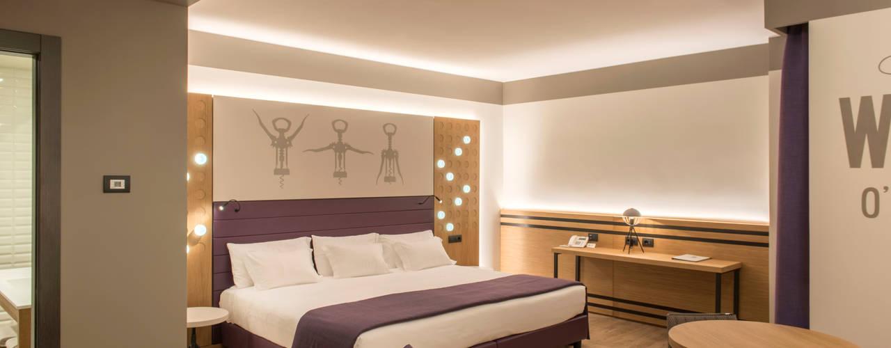 Hotel Soave - Best Western Fab Arredamenti su Misura Camera da lettoLetti e testate Legno Viola/Ciclamino