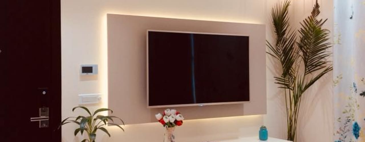 Residence at Astaire Gardens, Gurgaon:  Living room by INTROSPECS