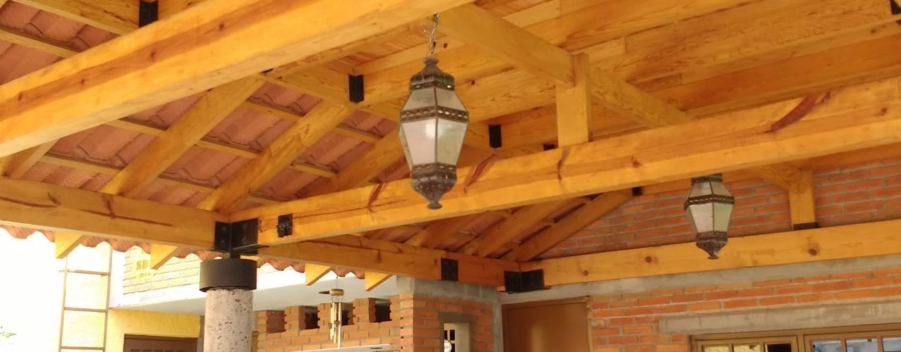 Jardín Naranjos QUIRSA arquitectos Balcones y terrazas rústicos