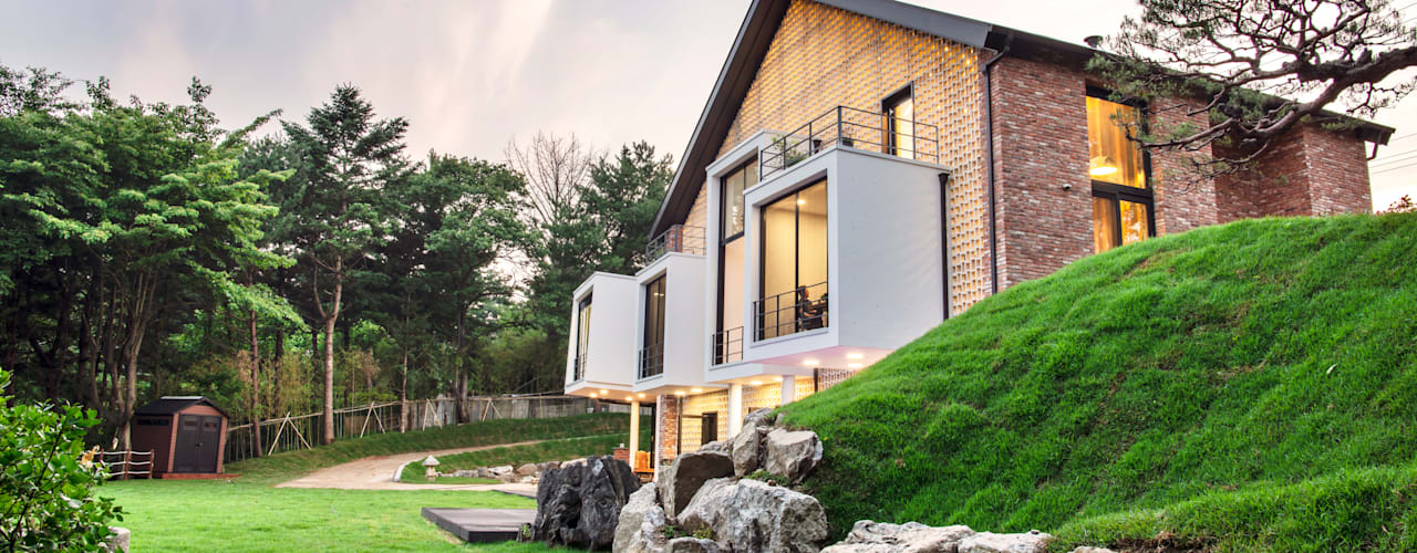 Maisons de style  par 위 종합건축사사무소
