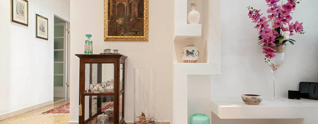 nA.nA. Project (iLove U) Luca Bucciantini Architettura d' interni Ingresso, Corridoio & Scale in stile minimalista Bianco