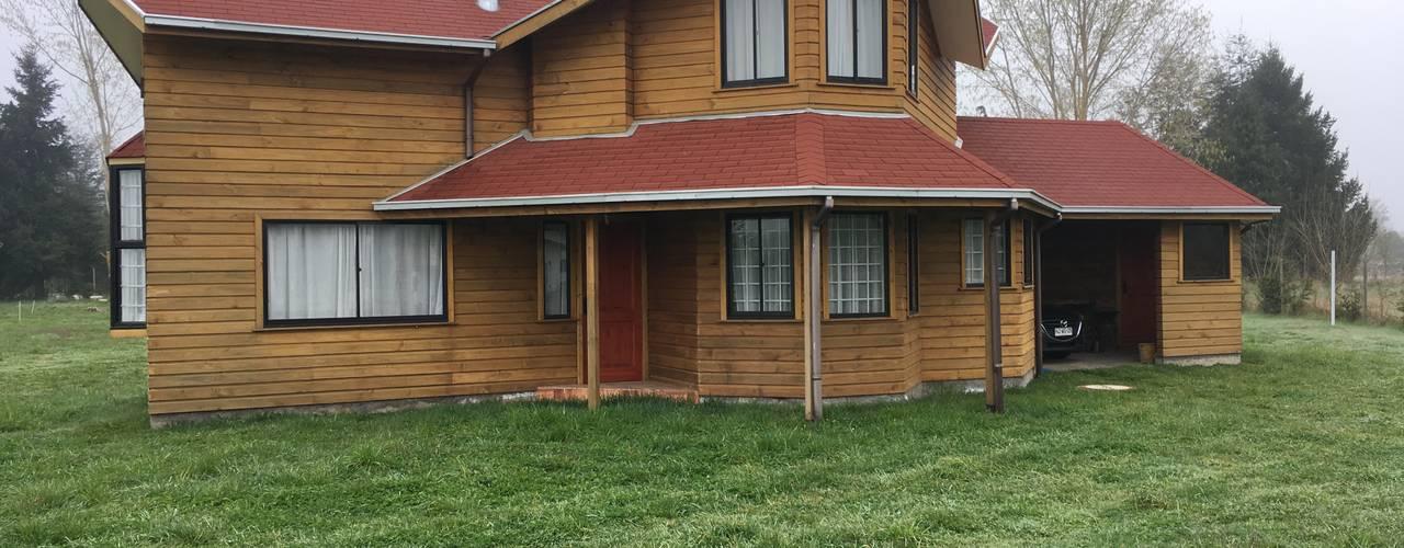 Vivienda V: Chalets de estilo  por Nomade Arquitectura y Construcción spa