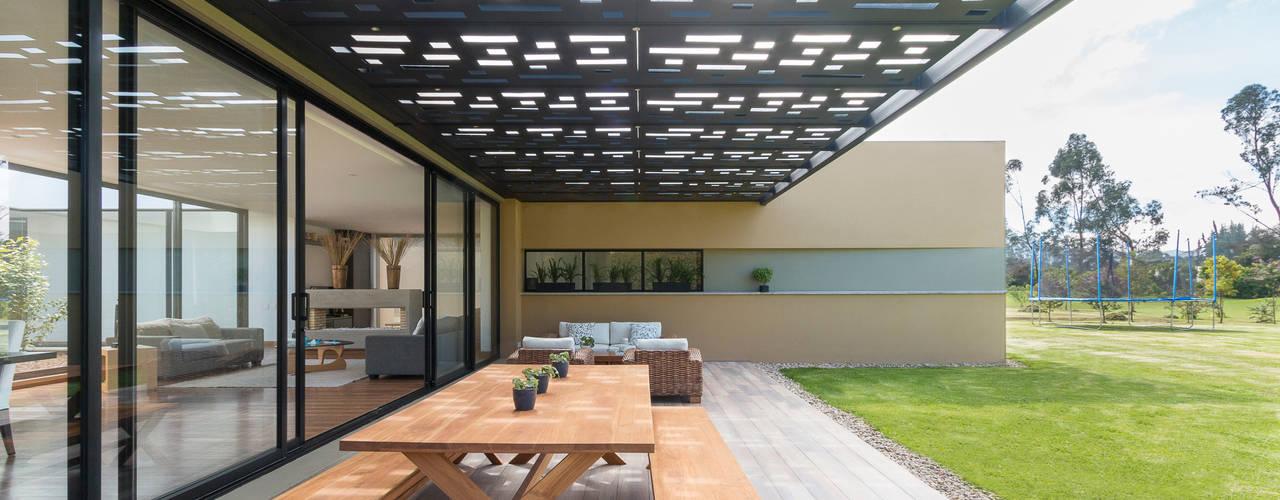 Casa el Molino Balcones y terrazas de estilo minimalista de David Macias Arquitectura & Urbanismo Minimalista
