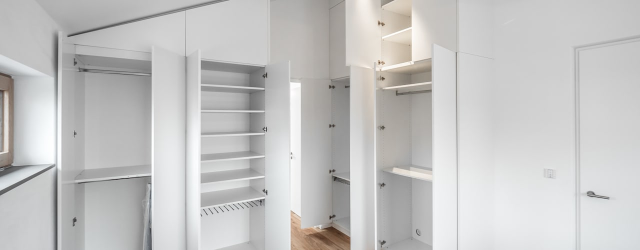 Closets  por Mannsperger Möbel + Raumdesign