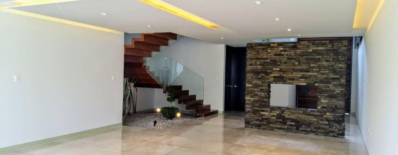 Pasillos y vestíbulos de estilo  por Herrera Arquitectos H&H