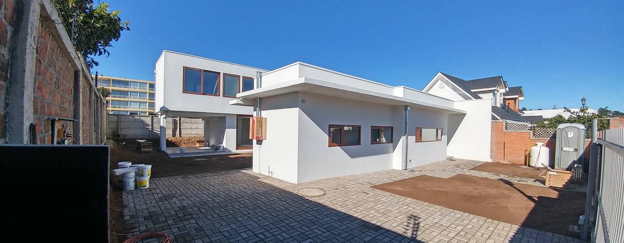 Casa Lomas De Montemar: Casas unifamiliares de estilo  por Lau Arquitectos, Moderno