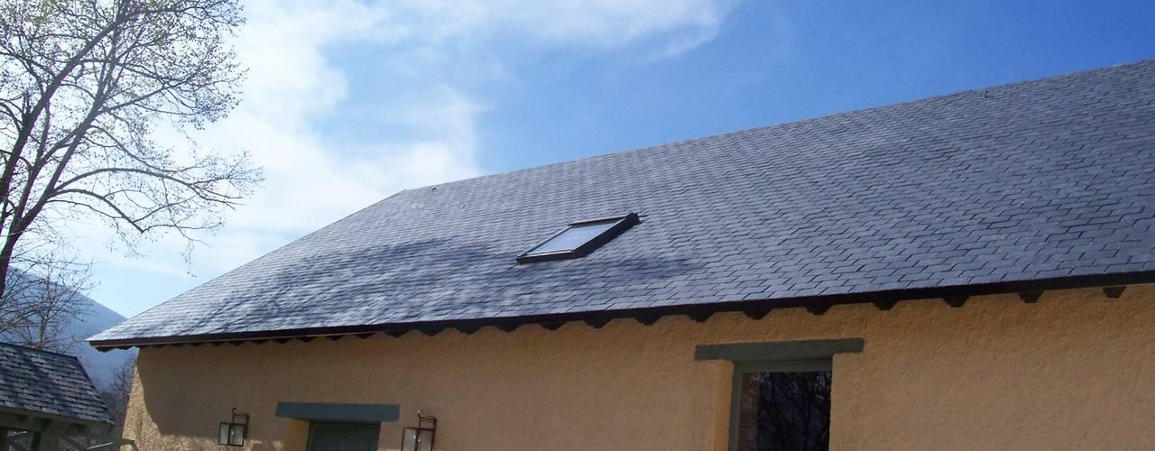 Reparación de tejado de pizarra en Segovia: Tejados de estilo  de Recasa  S.L.