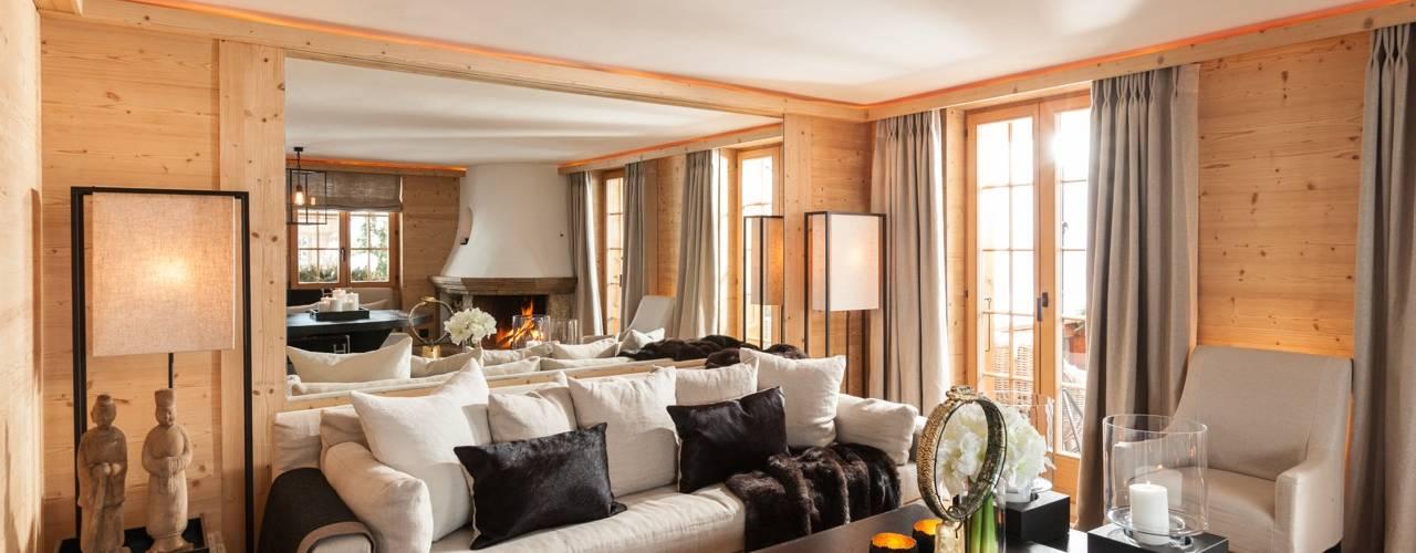 Wohnungsumbau in Chalet:  Wohnzimmer von RH-Design Innenausbau, Möbel und Küchenbau Aarau,