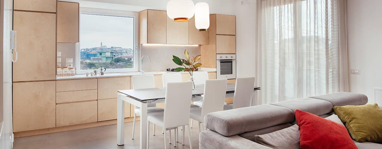 Open Space cucina e living: Cucina attrezzata in stile  di manuarino architettura design comunicazione