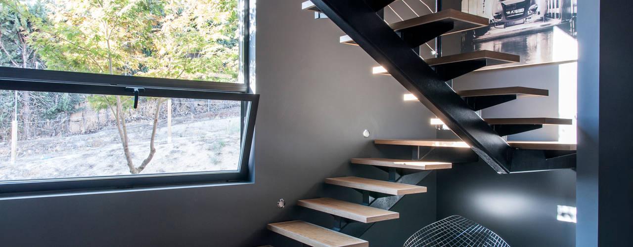 Ampliación modular para vivienda en Majadahonda MODULAR HOME Escaleras Madera