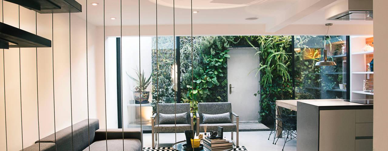 Casa CHAHER Salas modernas de CHAVARRO ARQUITECTURA Moderno