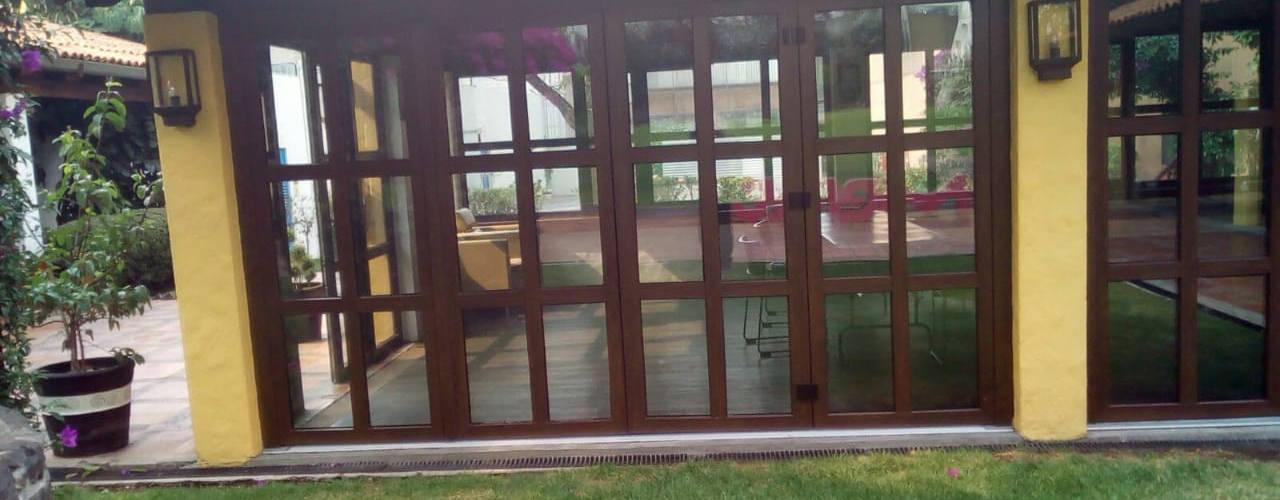 Proyecto Merck FENSELL Puertas y ventanasPuertas Plástico Acabado en madera