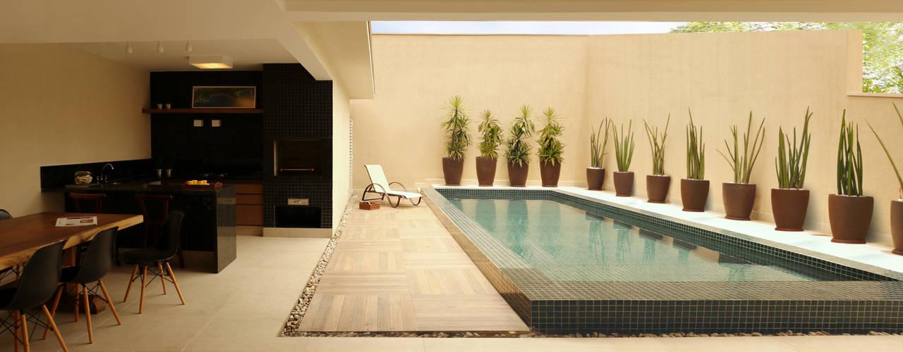 Casa Costa do Sol, Bertioga/SP por RAWI Arquitetura + Design Moderno