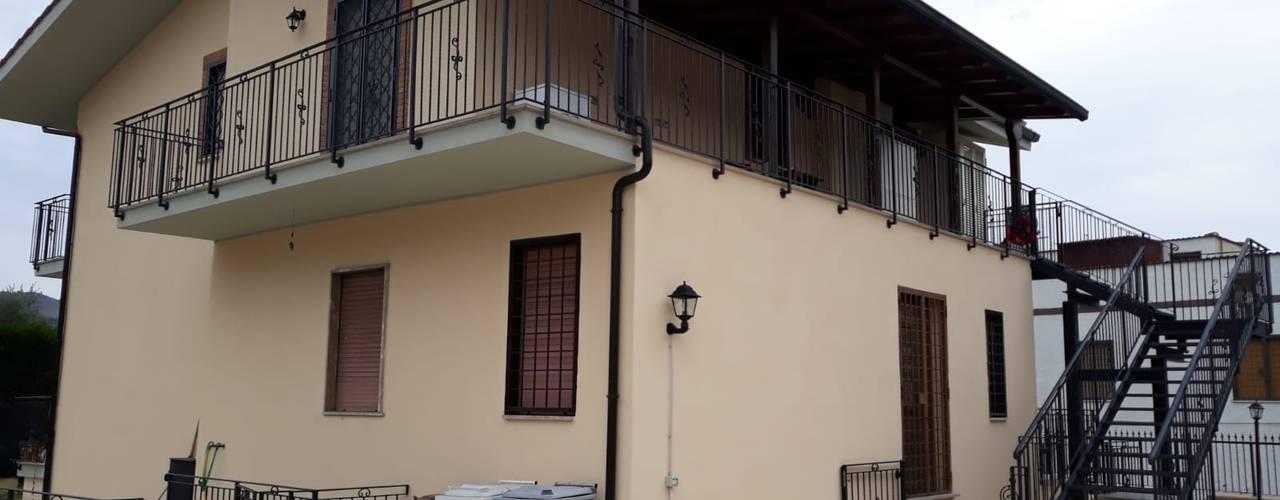 RISTRUTTURAZIONE DI UNA VILLETTA CON EFFICIENTAMENTO ENERGETICO Architetto Paolo Cara Casa unifamiliare Beige