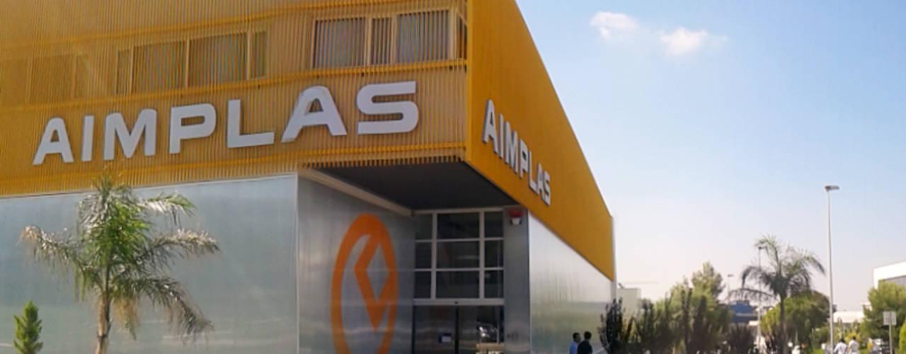 OBRA NUEVA: Edificio de Oficinas y laboratorios para centro de desarrollo de nuevos materiales plásticos para instituto tecnológico Casas de estilo industrial de OCTANS AECO Industrial